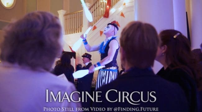 LED Club Juggling, Teal, Gold, Cirque, Imagine Circus, Oddball Gala, Performer, Adam, Photo still from video by Finding Future