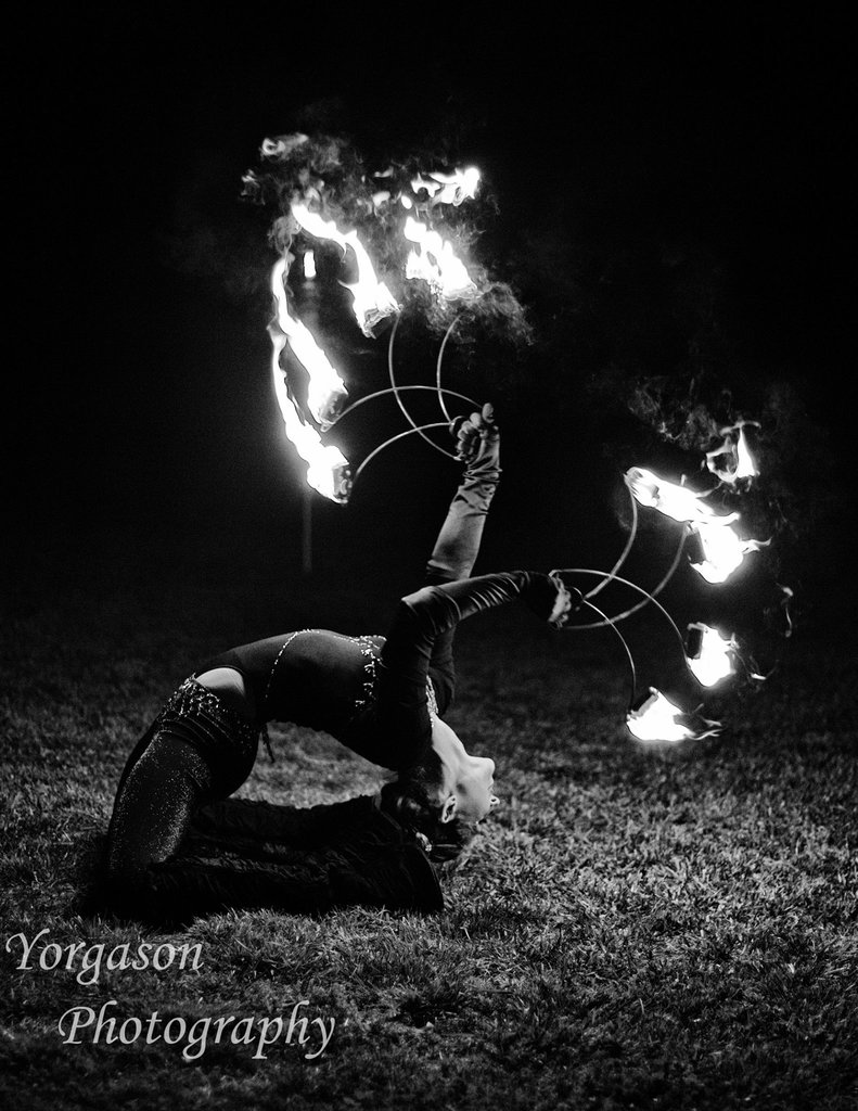 With Adult fire performer