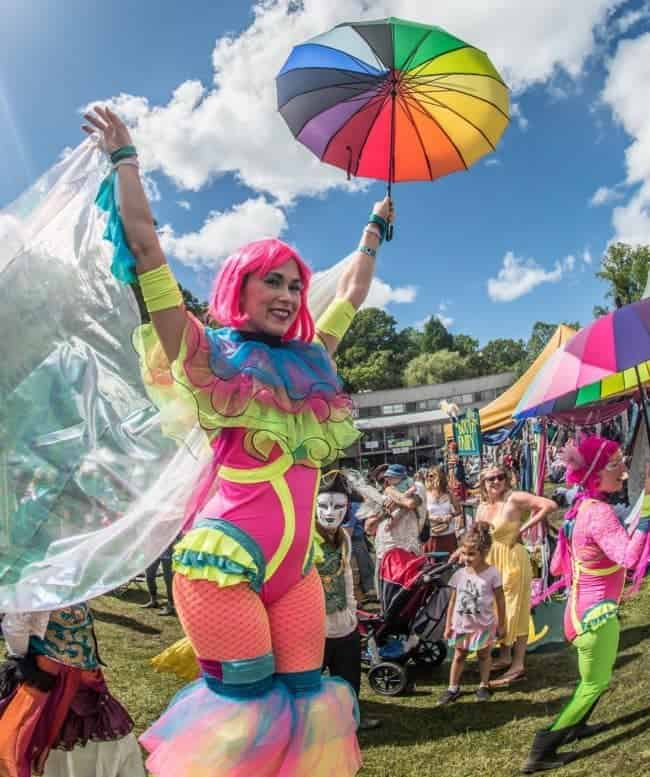 Stilt Walker leading parade at Lake Eden Arts Festival | Mindy | Imagine Circus Performers | Photo by Steve Atkins