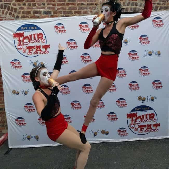Acrobats enjoying a beer at Tour de Fat in Charlotte, NC | Kaci & Katie | Imagine Circus Performers