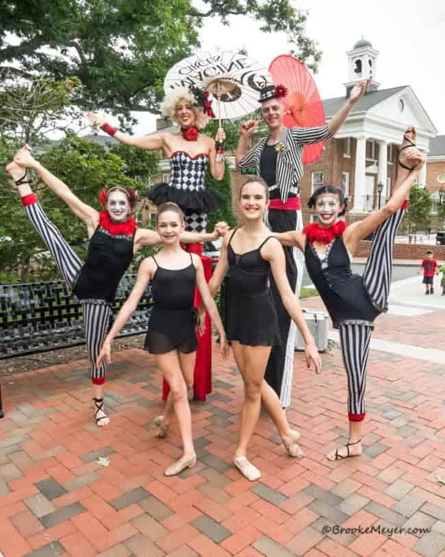 Stilt Walkers Adam & Liz | Acrobats Kaci & Katie at | Downtown Cary Celebration | Photo by Brooke Meyers | Imagine Circus