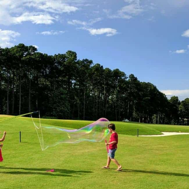 Bubble Artist Katie making giant bubbles on July 4 | Raleigh North Ridge Country Club | Imagine Circus