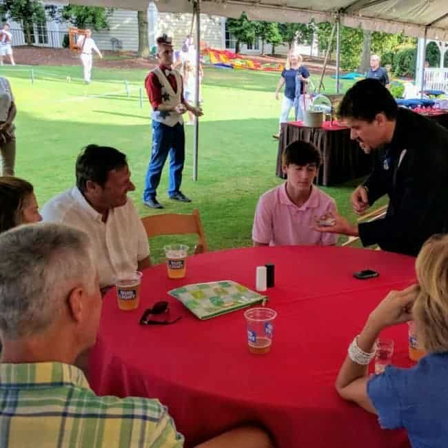 Roman the Magician entertaining guests on July 4 | Raleigh North Ridge Country Club | Imagine Circus