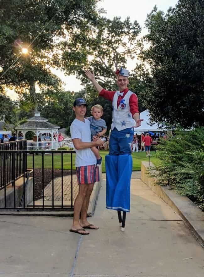 Stilt Walker Adam entertaining guests on July 4 | Raleigh North Ridge Country Club | Imagine Circus
