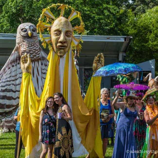 Paperhand Puppet Intervention leading parade   Imagine Circus