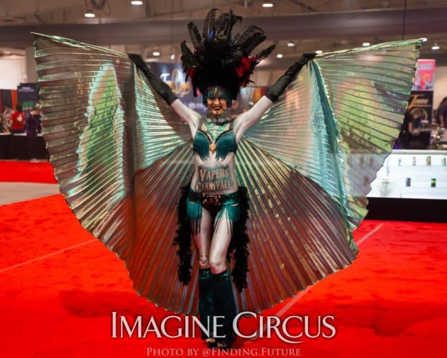 Dark Circus, Isis Wing Dancer, Tik-tok, Logo Branded Bodypaint, Vapers Carnivale, Imagine Circus Performers, Photo by Finding Future
