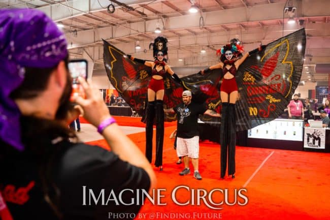 Dark Circus, Stilt Walkers, Liz and Kaci, Logo Branded Wings, Vapers Carnivale, Imagine Circus Performers, Photo by Finding Future