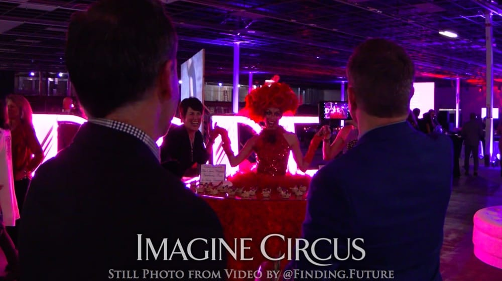 Kaci, Red Rose Strolling Food Table, VAE Gala, Imagine Circus, Still from video by Finding Future